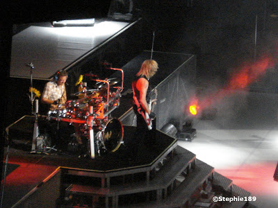 Rick Savage, Rick Allen, Def Leppard live; zoomed in from the nosebleed seats.