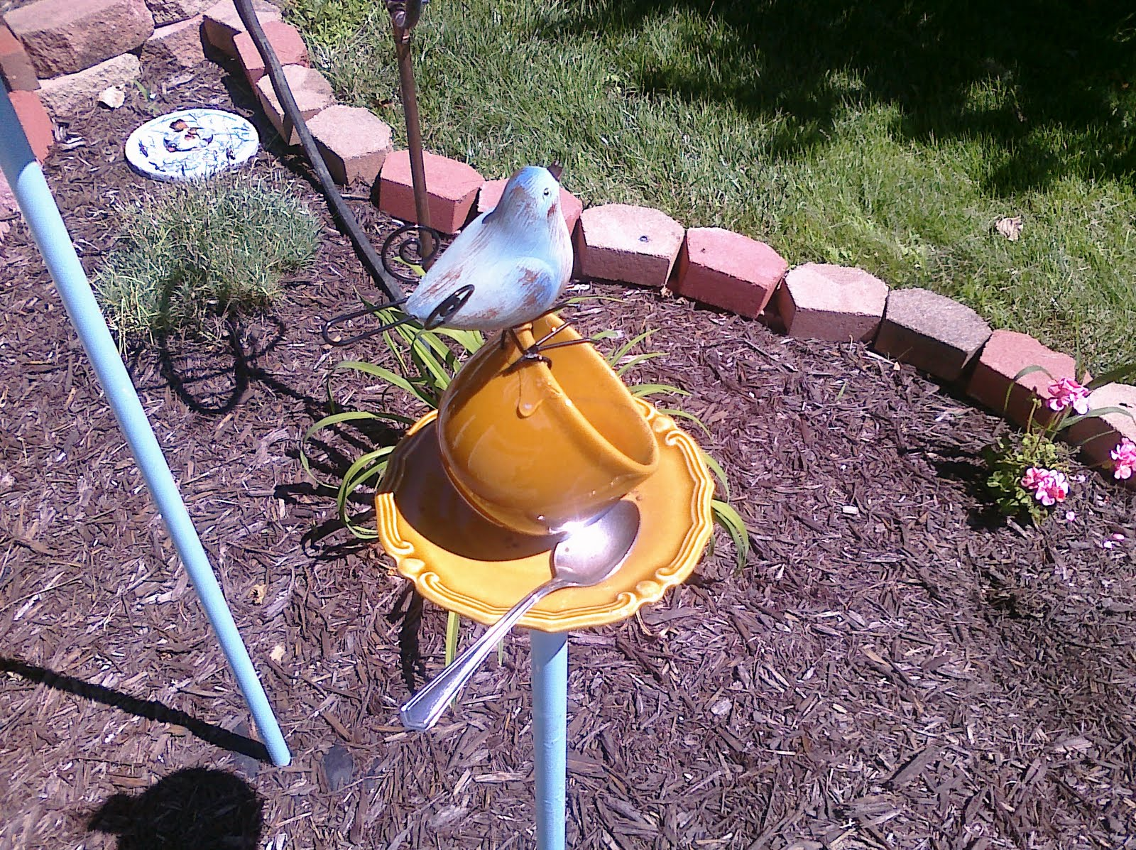 how to stop bird seed from growing under feeder
