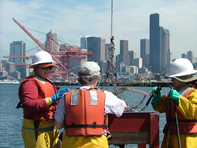 Photo of Ecology crew on Elliot Bay taking sediment samples