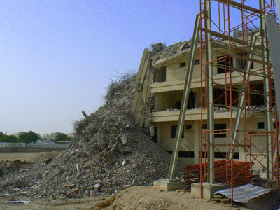 A building being knocked down on C ring road in Qatar