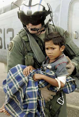 American solider helping an Indonesian boy