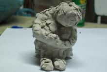 """""""El hombre emplumado"""" escultura en arcilla"""