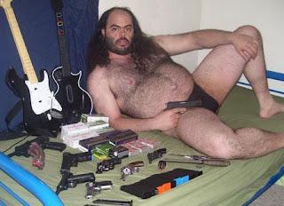 Creepy+speedo+guy+with+guns.jpg