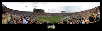 Panoramic black bordered photo of cheering fans at a University of Central Football football game.