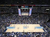 An upper deck mid court view of a Memphis Tiger basketball game.