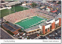 Aerial view of a fan filled Marshall University football stadium during an evening game.
