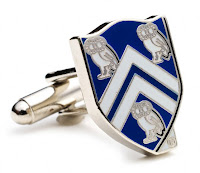 Blue rice University cuff links with owls.