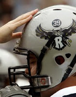 Silver Rice football helmet with owl.