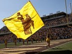 Large yellow Wyoming flag at a University of Wyoming football game.