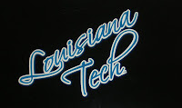 Louisiana Tech written in cursive blue letters.