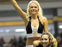 University of Idaho cheerleaders smile.