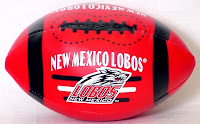 New Mexico Lobos red stuffed toy football.