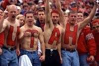Football fans paint chests at University of Utah game with UTAH.