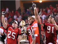 Utah players celebrate with Sugar Bowl victory trophy.