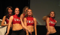 UNLV dance team smiling in red tops.