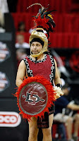 SDSU student dressed up as Aztecs mascot as basketball game.