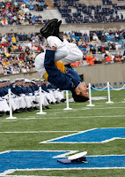 Air Force cadet does a flip on football field.