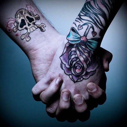 Hands   Skull and Rose by Spoonford Incredible Tattoo Designs and Body Art to Inspire You