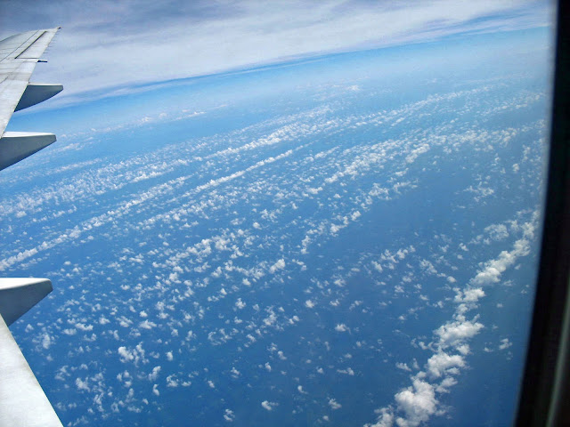 tiny fluffy clouds over the ocean