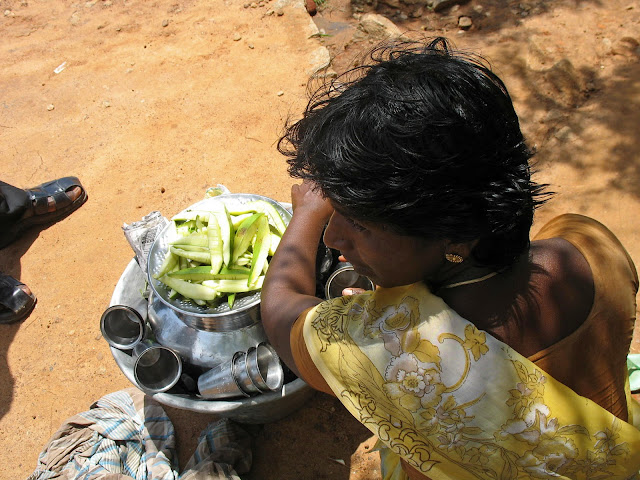 young woman selling raw mango slices in India