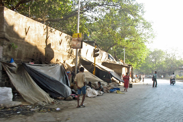 tents on pavement by homeless