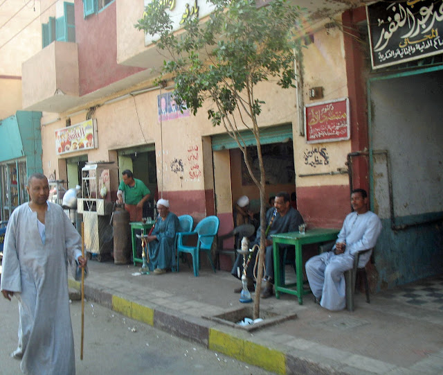 men smoking hookah in Cairo