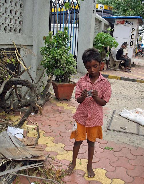 small boy examining plastic thingie