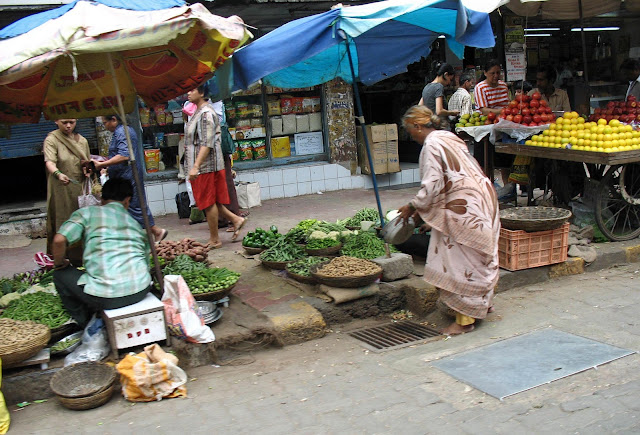 vegetable sellers on pavement