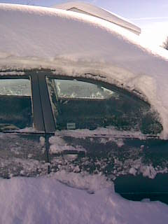The car door, with two and a half feet of snow atop the car