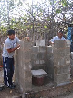 Villagers building latrine