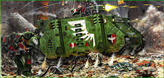 Space marines of the dark angels chapter under fire while disembarking from their troop transport