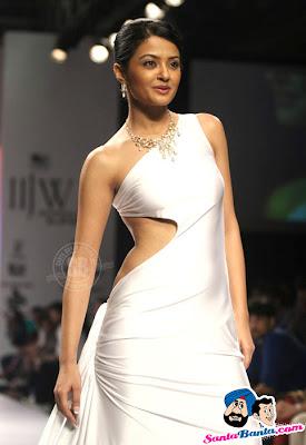 Surveen Chawla wearing Hot White Backless Dress in IIJW-2010