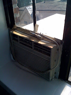 air conditioner window unit in steel casement window