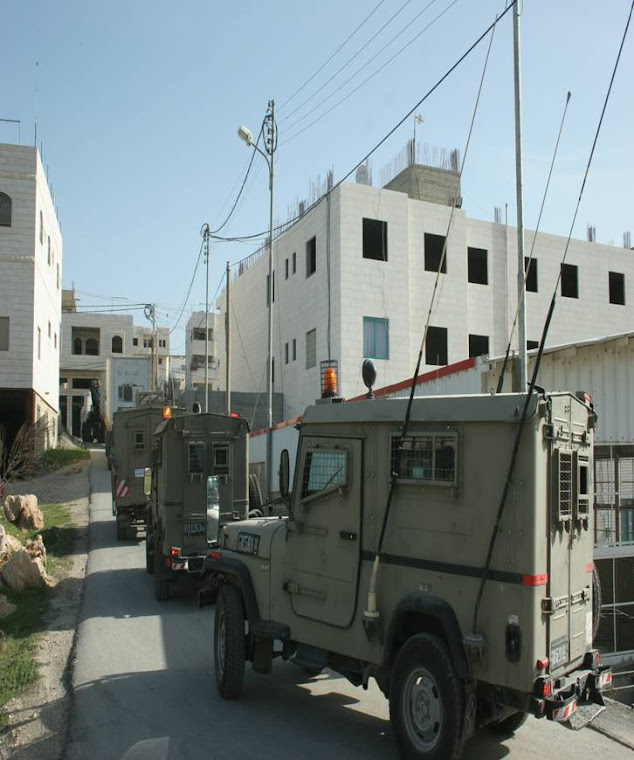 Israeli jeeps leaving the warehouse after the raid