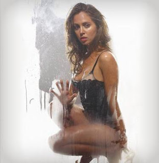  Actress Eliza Dushku is baring almost all at the last series of promotional images for a new television science fiction series called Dollhouse.