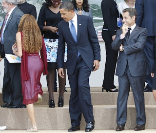 A deceiving image of U.S. President Barack Obama staring at Mayora Tavares butt while French President Nicolas Sarkozy noticing