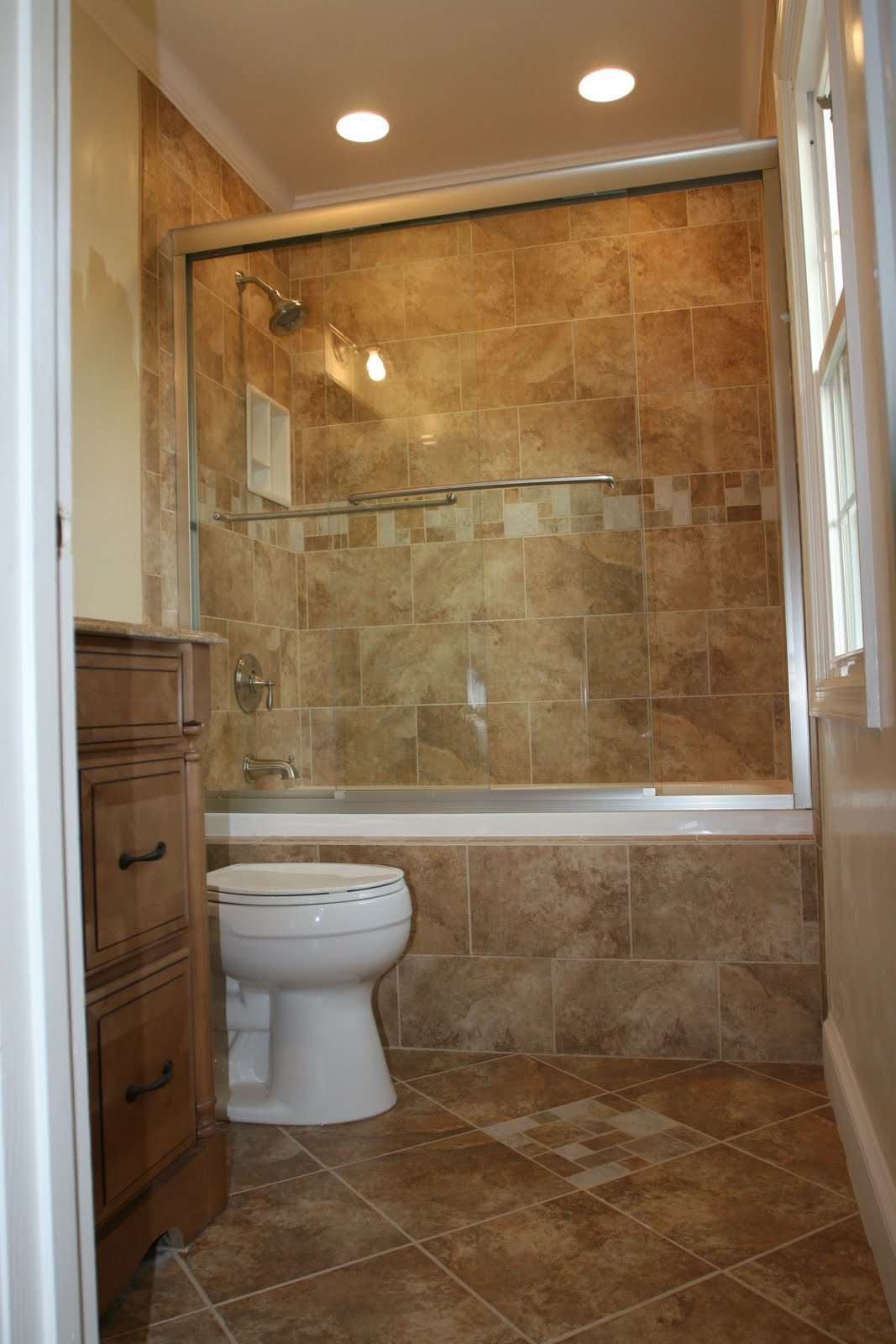look of your bathroom hides the tub and makes a classy master bathroom