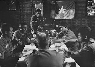 ''Green Berets' at a poker game at outpost of Buon Brieng,' Saigon, Vietnam, Nov 1964, photo by Larry Burrows, part of Life Magazine collection