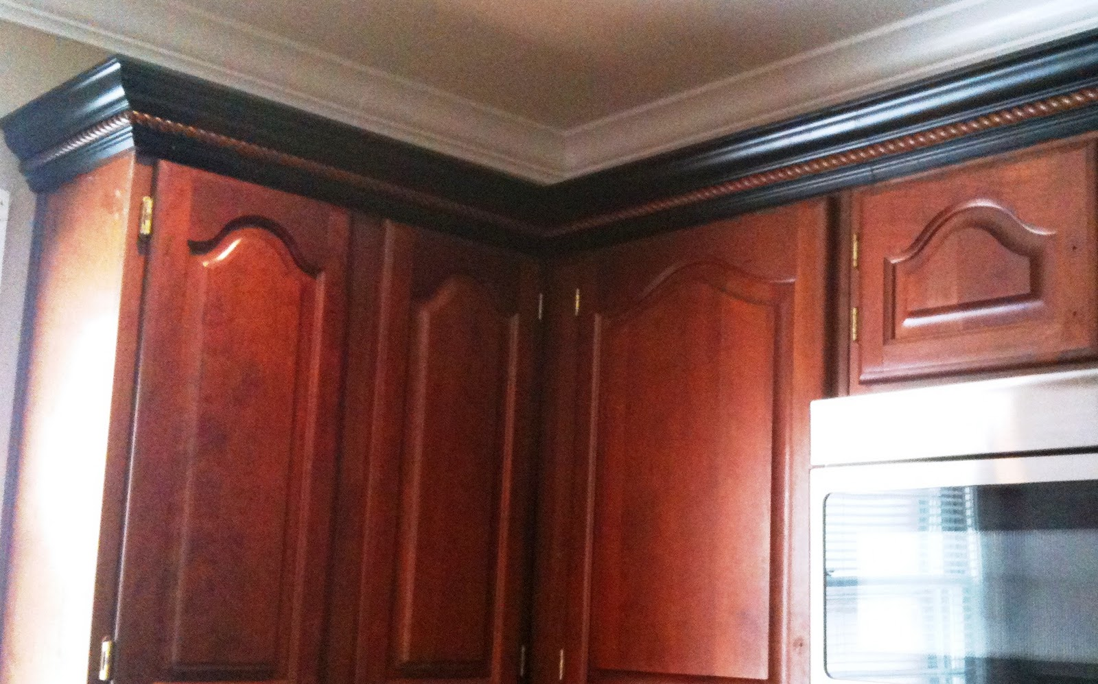Black Kitchen Cabinets with Crown Molding