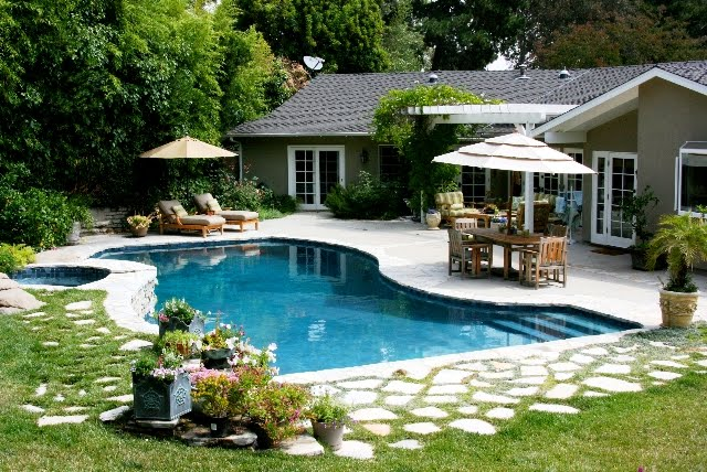 Linda Grasso of Shesez's California backyard with a pool and outdoor living room