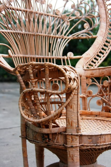 Close up of the detail on a vintage wicker peacock chair