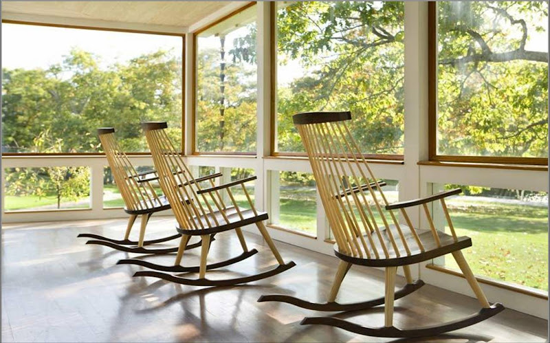 Three rocking chairs on a sun porch overlooking a sunny backyard