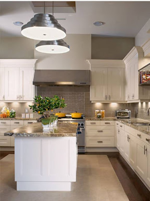 Kitchen by Deborah Wecselman with recessed paneled cabinet doors, stainless appliances, marble counter top and a dark wood and porcelain tile floor