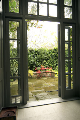 French doors lead to a lush city garden in London