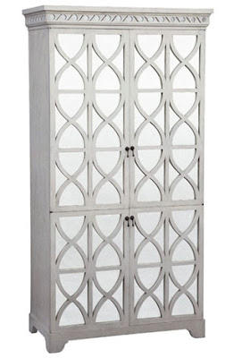 antiqued white one piece entertainment center with antiqued mirror split doors from Mecox Gardens