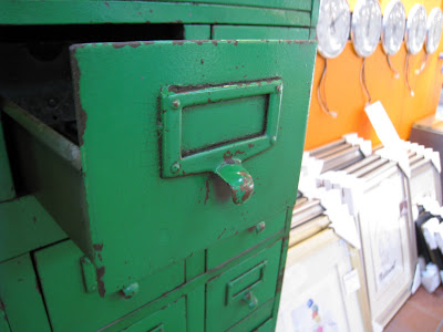 Drawer in a vintage green steel card file cabinet