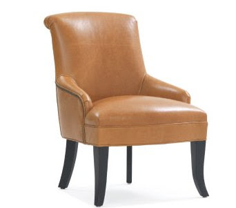 Tan leather chair with nail head trim from Mitchell Gold & Bob Williams