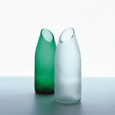 Green and clear handle less carafe with an asymmetrical spout by tranSglass from Zwello