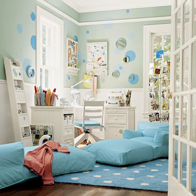 Kid's bedroom with white desk and hair, mint green walls with blue