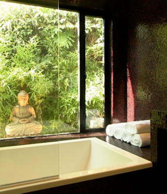 Close up of the bathtub, picture window with a view of a bamboo garden and a Buddha statue in a master bathroom after The Sunset Team/La Kaza Design's remodeling